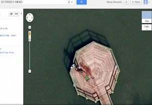 Two men dragging bleeding body on Google maps